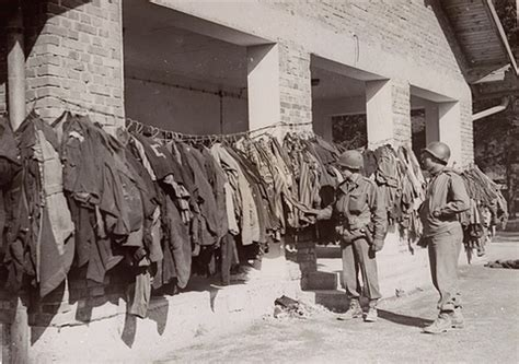 American Soldiers Inspect Disinfected Uniforms at Dachau