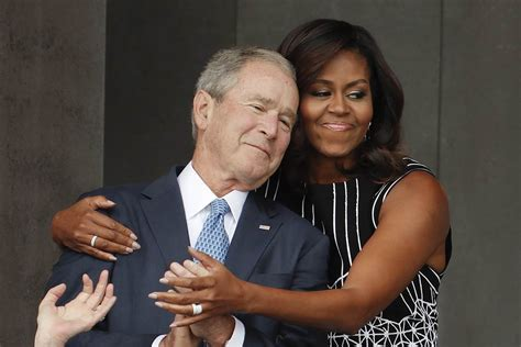 The Hug Felt Around The Country: Michelle Obama, George W