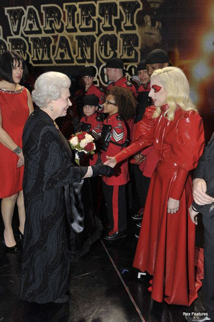 SEE PICS! Lady Gaga meets the Queen wearing red latex