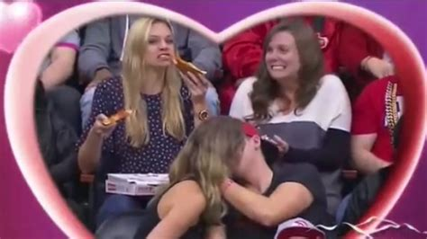 Hero woman crushes two slices of pizza during kiss cam